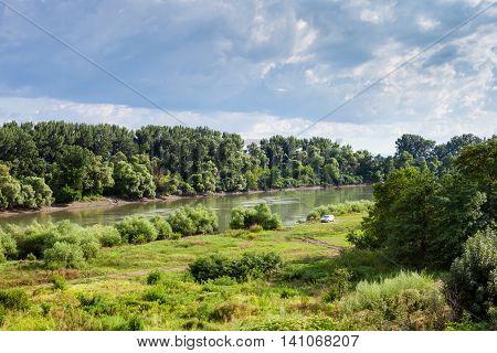 Green Meadow Along Kuban River In Summer Day