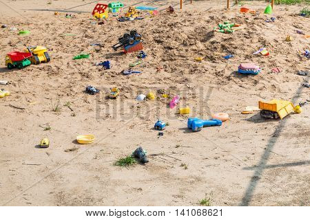 Abandoned Toys In Outdoor Sand Playground