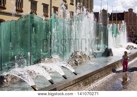 WROCLAW POLAND - SEPTEMBER 05 2010: The modern fountain on the Market square in Wroclaw Poland. The Market square is situated in the historical centre of Wroclaw.