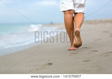 Closeup of a Person Walking on the Beach