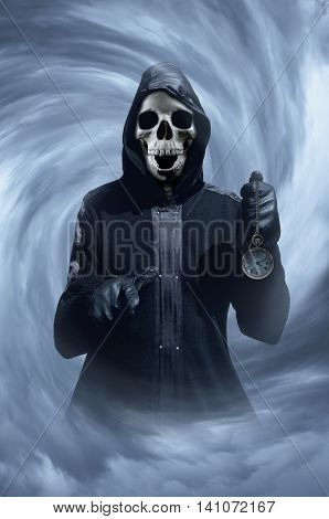 Skeleton in hood with clock. Skeleton holding clock. Gothic concept. Horror concept. Halloween concept.