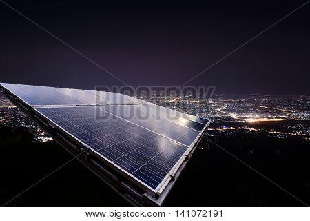 Solar panel with city night light background.
