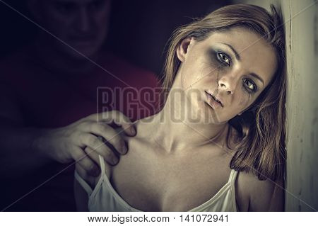 Woman victim of domestic violence and abuse. Tears of a young woman