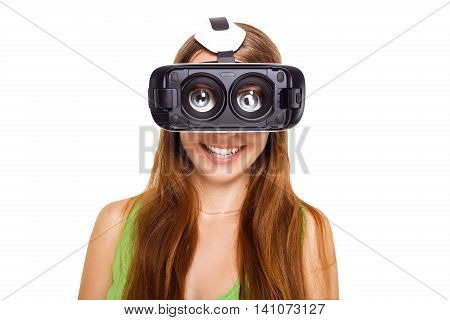 Portrait of happy smiling young beautiful girl getting experience using VR-headset glasses of virtual reality, big eyes, funny style. Isolated
