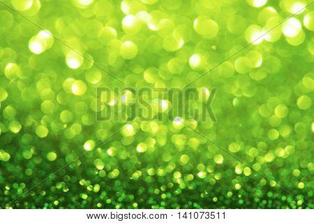 Sparkling or shimmering green background. Intense sparkle. Soft focus.