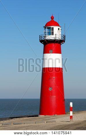 Red lighthouse in Zeeland, Netherlands, Sunny day