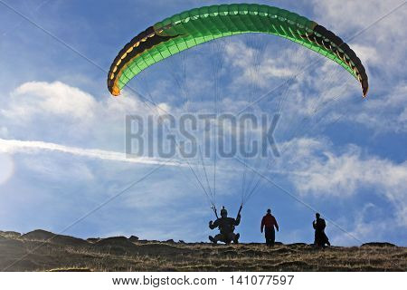 Paraglider launching his wing on Dartmoor, Devon