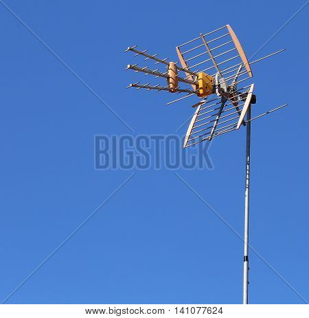 innovative television antenna to receive television programs and the background of the blue sky