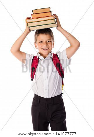 Happy funny schoolboy standing with book over head, isolated on white