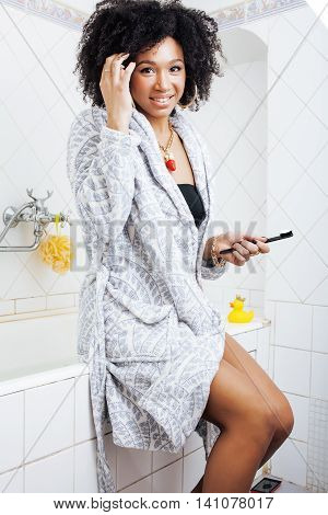 beauty young african american woman in bathrobe with tooth brush taking morning care of herself, lifestyle concept, emotional swag