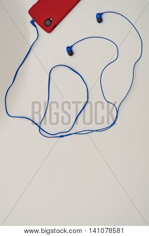 Smart Cell Phone With Earbuds on White Background