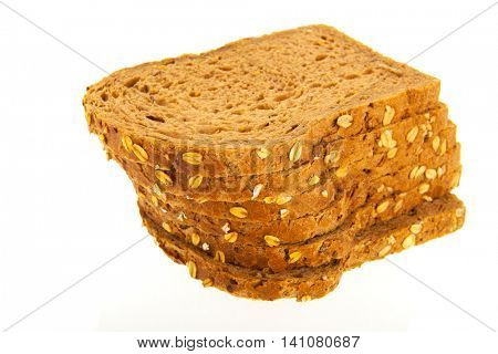 Stacked wholemeal slices of bread isolated over white background