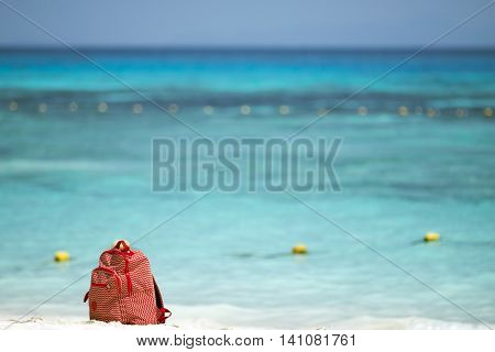 Red Bag On The Beach