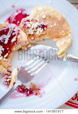 Breakfast including pancakes with raspberry jam. Healthy breakfast. Good morning. Breakfast table. Morning breakfast with classic pancakes and jam. Top view.