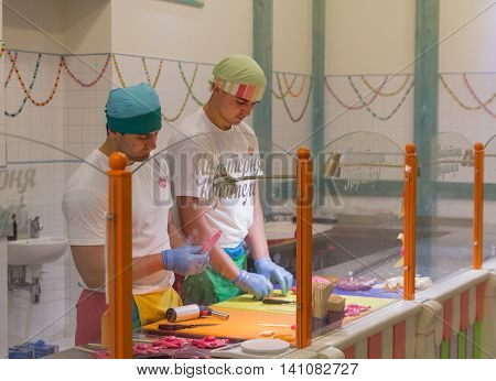 Lviv Ukraine - October 18 2015: Man confectioners at work in the store-studio for the production of caramel