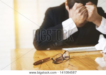 Businessman With Hand On Head In Office - Upset, Frustrate, Stress Concept - Blur