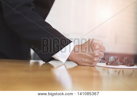 Fist Of Businessman On Office Desk - Angry And Furious Business Concept