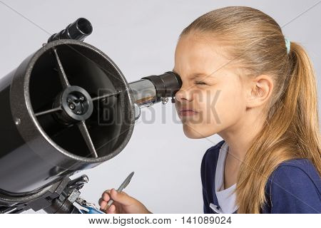 The Young Astronomer Looks Through The Eyepiece Of The Telescope And Record Results