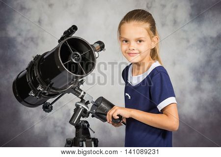Seven-year Girl Adjusts The Telescope And Looked Into The Frame