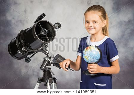 Seven-year Girl Is Happy With The Globe In A Reflector Telescope