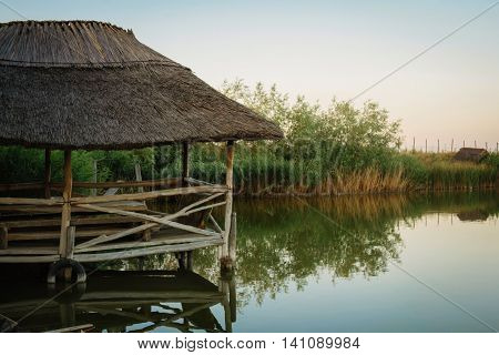 Fishing terrace on a freshwater lake outdoor summer wooden on sunrise
