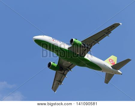 Moscow region - 31 July 2016: Large passenger plane Airbus A-319-114 S7 Airlines flies to Moscow's Domodedovo airport July 31 2016 Moscow Region Russia