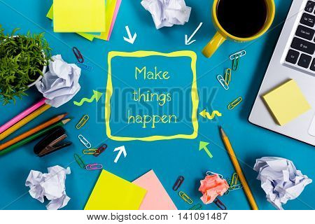 Make things happens. Office table with notepad, computer and coffee cup on blue background. Business creative consept top view