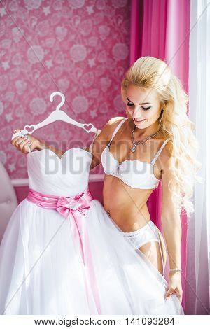Beautiful young bride underwear. Last preparations for the wedding. Morning the bride.