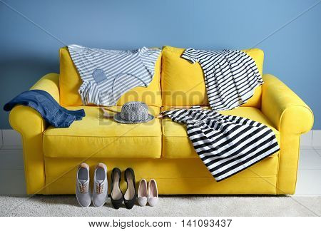 Family clothes on the yellow sofa