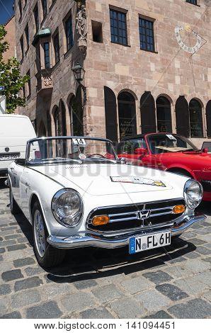 Nurnberg Bavaria / Germany - July 19th 2014: white Honda S 800 sportscar at Sud - Rallye- Historic event in Nurnberg