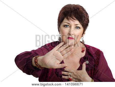 Mature woman requires stay away from her personal space. Posed portrait of woman with short dark brown wig shows reject gesture and looks at the camera
