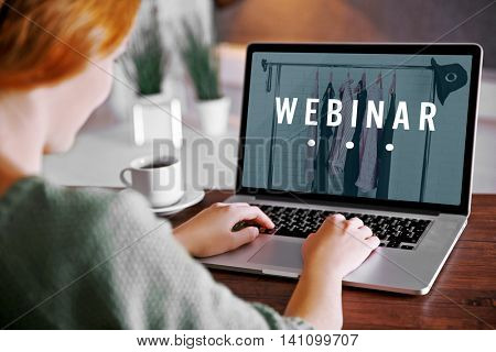 Young woman using his laptop, close up. Webinar concept