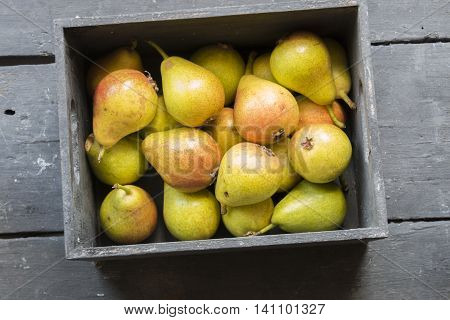 Healthy Organic Pears, pears in a box on a wooden table