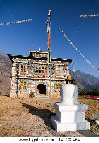 Buddhist monastery or gompa in Kharikhola village with prayer flafs near Lukla way from Jiri Bazar to Everest area Khumbu valley Solukhumbu Nepal