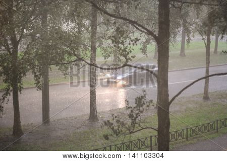 Powerful downpour fell upon the city streets.