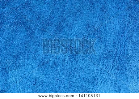 Blue embossed decorative leatherette texture background, close up