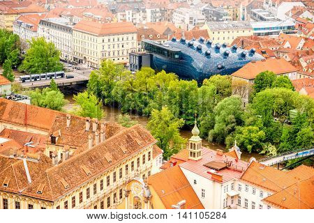Graz, Austria - Augusts 3, 2016: Aerial view on graz city with modern building of art gallery named Kunsthaus. Kunsthaus is famous architectural landmark in Graz