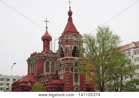 The eastern orthodox church in Harbin China on a gray overcast day in Heilongjiang province.
