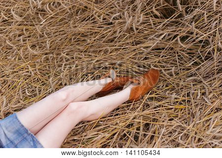 Girl in short skirt lies on the grass