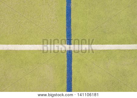 Worn Out Plastic Hairy Carpet On Outside Hanball Court. Floor With Colorful Marking Lines.