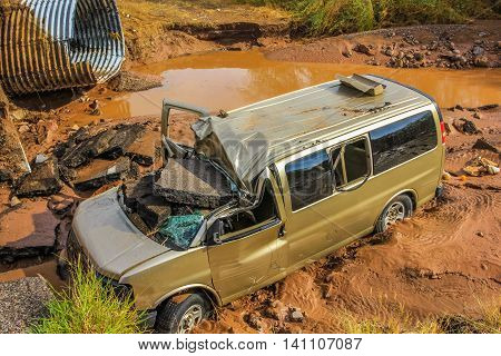 Nopolo, Baja, Baja California Sur, Mexico - August 25, 2013: Smashed cars and plunged into the river of mud during the tropical storm named Juliette