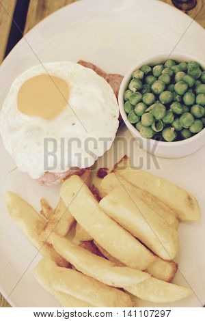 Gammon, fried egg with chips and peas