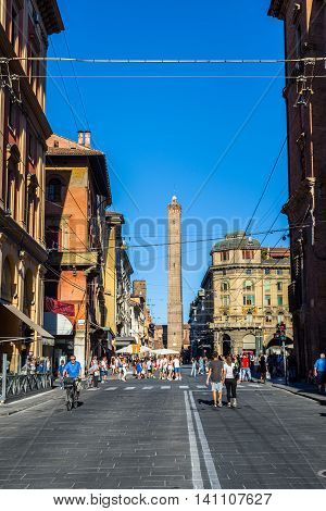 Bologna Italy - July 17 2016: Via Ugo Bassi street of Bologna with Two towers Garisenda and degli Asinelli in background. Emilia-Romagna. Italy.