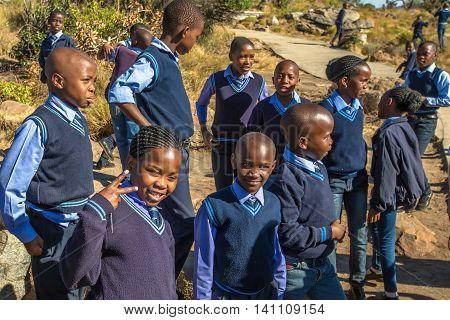 Blyde River Canyon Nature Reserve, South Africa - August 22, 2014: South African smiling boys and girls kids posing in school uniform.
