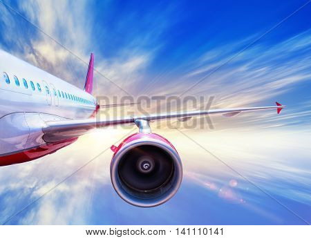 airliner in the sky against a sunset