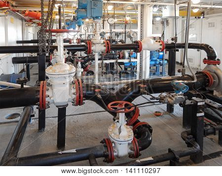 Pipes and valves in the pump condensate station.
