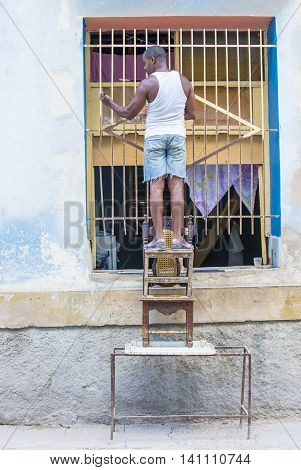 HAVANA CUBA - JULY 18 : A portrait of a Cuban man in old Havana street on July 18 2016. The historic center of Havana is UNESCO World Heritage Site since 1982.