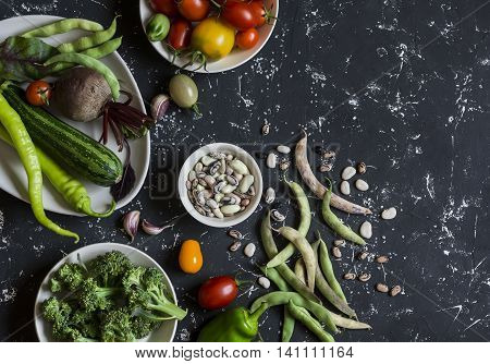 Food background. Assortment of fresh vegetables on a dark background. Top view free space for text
