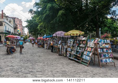 HAVANA, CUBA - APRIL 1, 2016: Book market in the Plaza de las Armas square in the Old Havana neighborhood of Havana