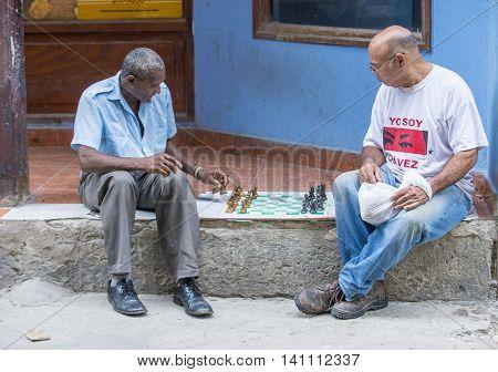 HAVANA CUBA - JULY 18 : Unidentified men play chess on the street on July 18 2016 in Havana Cuba. Chess is one of the most popular games in Cuba